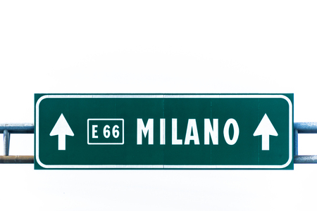 Green highway to Milano sign isolated on white. Stock fotó