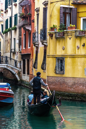 Canal in Venice with a gondolier, Italy