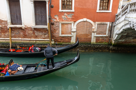 Canal in Venice with gondolier, Italy