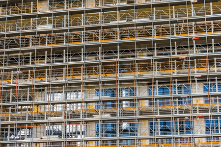 Construction scafold to restore building in Milan, Italy