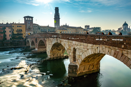 Panoramic view of Ponte Pietra bridge in Verona on Adige river, Veneto region, Italy