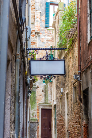 Traditional little street in Venice with a blank sign, Italy Stock fotó