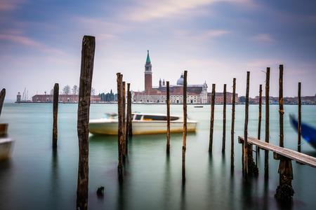 Gondolas moored in Piazza San Marco with San Giorgio Maggiore church in the background Stock Photo