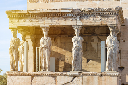 Detail photo of iconic Caryatids statues in porch of Caryatids located on top of Acropolis hill next to iconic masterpiece Parthenon, Athens historic center, Attica Imagens