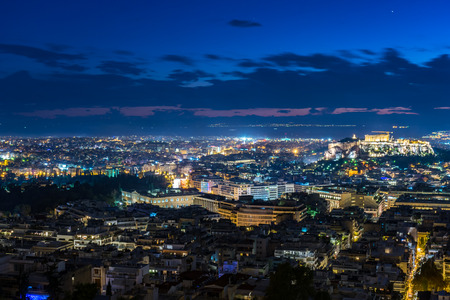 Cityscape of Athens with illuminated Acropolis hill, Pathenon at night