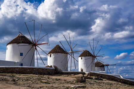 Scenic view of traditional greek windmills on Mykonos island, Cyclades, Greece Фото со стока