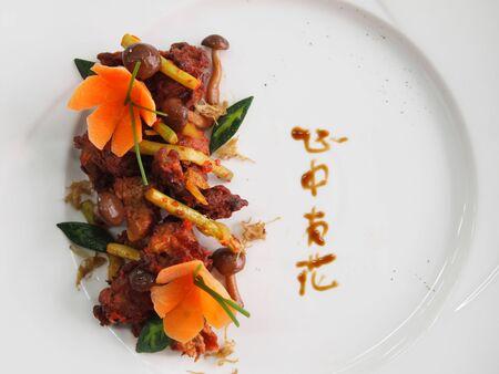 plating: Stir-fried spicy mock meat with braised mushrooms