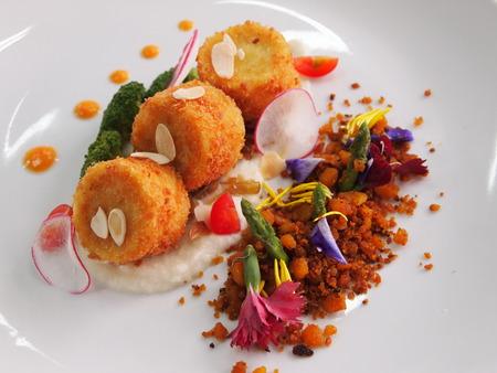 plating: Deep fried tofu. Cauliflower mousse. Deep-fried lentils.