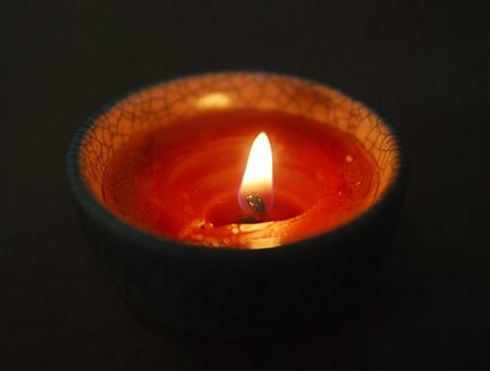 light from candle on dark background