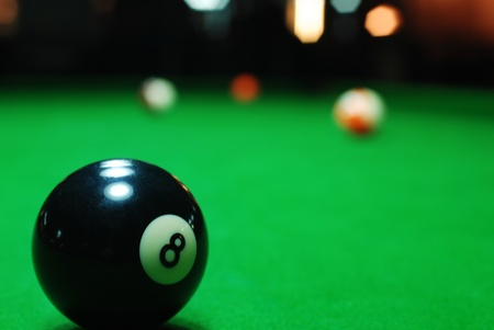 pool ball: Eight ball on pool table