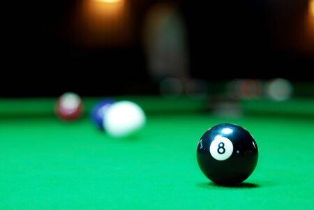 Eight ball on pool table photo