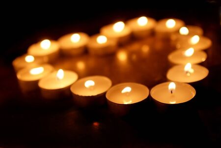 spa candles in low light condition heart