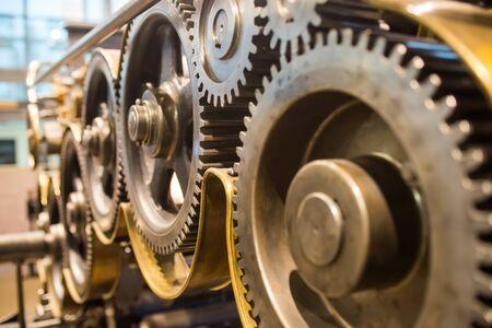 huge mechanical gears wheels at printery closeup view