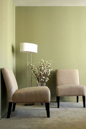 carpeting: Two Casual Chairs with Lamp and Vase with Flowers