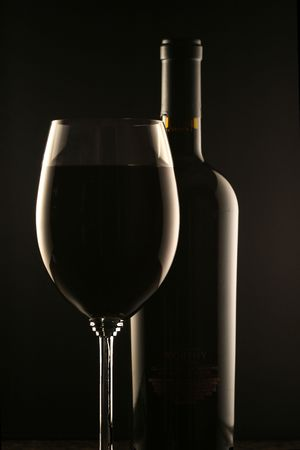 Wine Bottle and Wine Glass Stock Photo