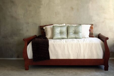 Daybed against Textured Green Wall Stock Photo