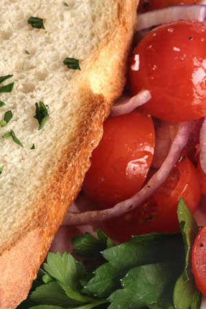 Close Up of Tomato and Onion Salad with Bread Stock Photo