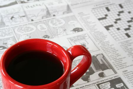 Red Coffee Mug on Newspaper