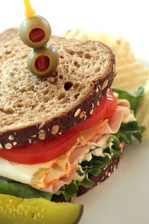 Bologna, Cheese, Lettuce and Tomato Sandwich with Pickle and Chips