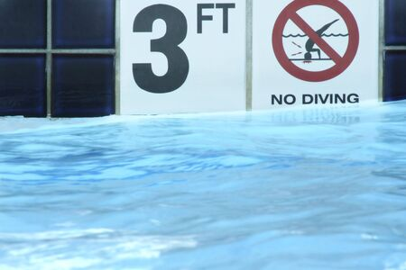 no diving sign: 3 Foot and No Diving Sign on Side of Swimming Pool