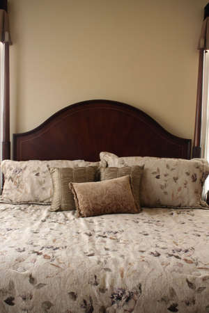 Luxurious Bed in Warm Tones photo