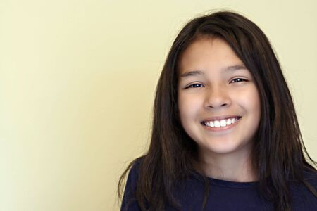 Cute Smiling Hispanic Teen Stock Photo
