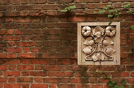 Brick Wall with Decorative Tile and Ivy Stock Photo - 2586229