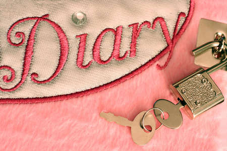 lock and key: Diary with Unlocked Lock and Key Stock Photo