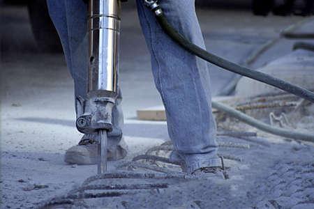 Construction worker using jack hammer