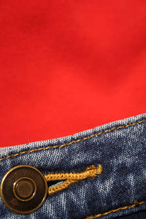 Close up of buttons on jeans with red shirt Stock Photo