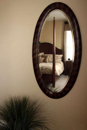 Mirror with bedroom reflecting photo