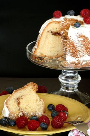 Coffee cake with raspberries and blueberries photo