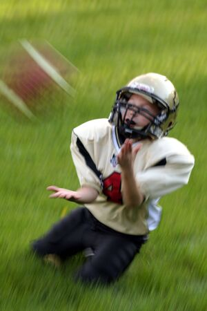 Youth boy catching a football Stock Photo