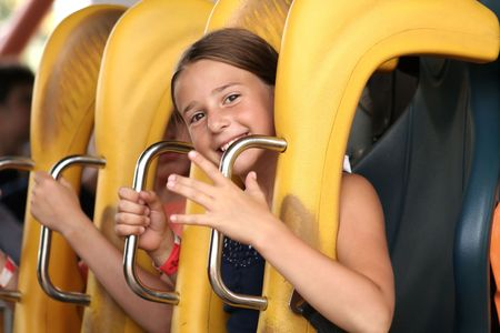 Cute girl on roller coaster Foto de archivo