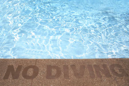 no diving sign: No Diving Sign on side of Swimming Pool Stock Photo