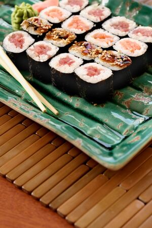 Assorted pieces of sushi and chop sticks Stock Photo