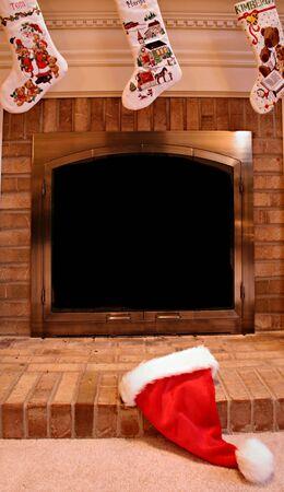 Santa Hat on Fireplace Stock Photo