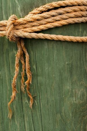 Rope Tied Around Wooden Post photo
