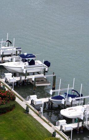 docked: Boats docked on pier Stock Photo