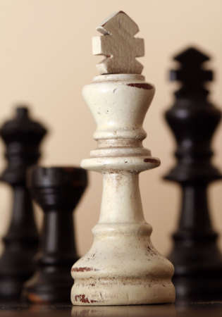 adversaries: White Chess Piece with Black Pieces in Sepia