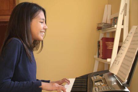 rehearse: Beautiful Hispanic Girl Playing Piano