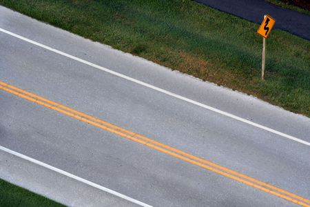 swerve: Straight Road with Curved Road Ahead Sign Stock Photo