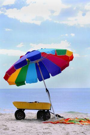 Beach Umbrella with Towel and Wagon photo