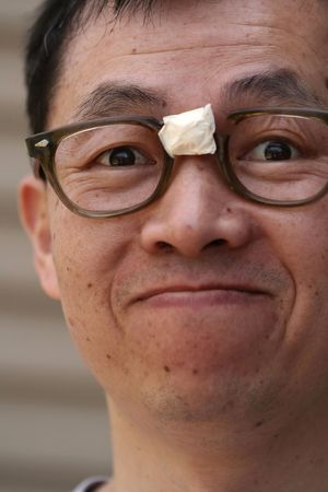 masking tape: Asian Man Wearing Nerdy Glasses with Masking Tape