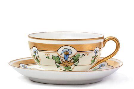 Antique teacup and saucer on white background Reklamní fotografie