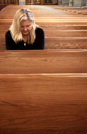 pew: Woman Praying in Church Pew