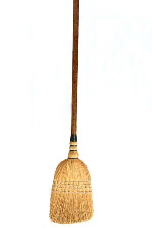 broom handle: Straw broom on white Stock Photo