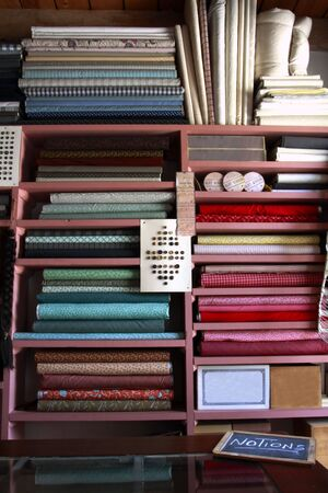 notions: Fabrics and buttons for sale in vintage general store
