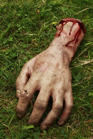 gruesome: Fake Hand with Blood Stock Photo