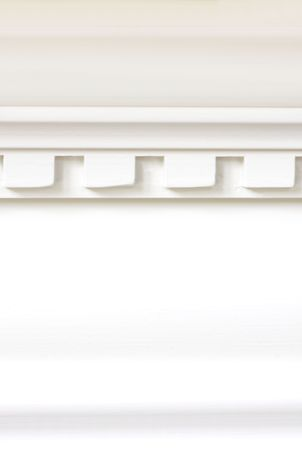 white trim: Close up of wood trim dental molding